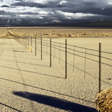 Dixie Valley fence line shadows across salt flats in Nevada
